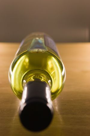 unopened: Unopened wine bottle on a wooden table