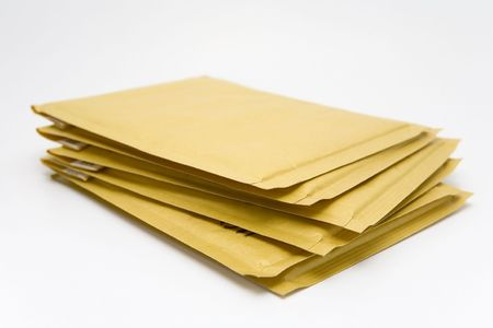 enclose: Thick envelope on a white background Stock Photo