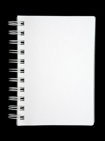 Open blank notebook on a black background