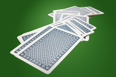risky situation: Stack of playing cards on a table Editorial
