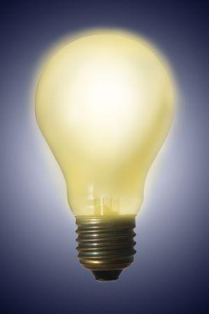 Glowing electric light bulb - great idea has born Stock Photo