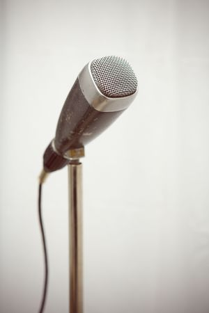 narrate: Professional retro microphone from sixties on a stand