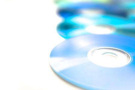 Recordable compact discs in an array - overexposed for graphical effect Stock Photo