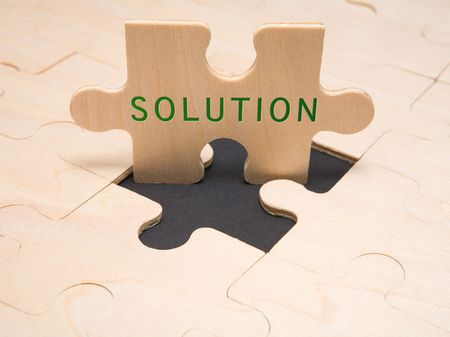Text Solution in a puzzle piece Stock Photo
