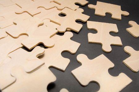 Assembling puzzle pieces Stock Photo - 1051045