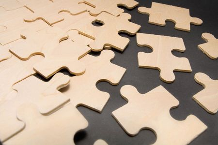 Assembling puzzle pieces Stock Photo - 1051045