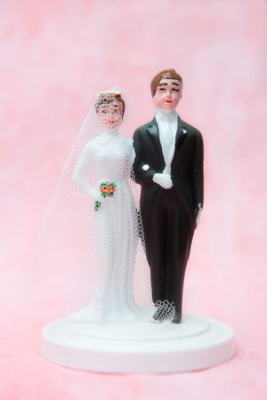Bride and groom - wedding cake decoration Stock Photo