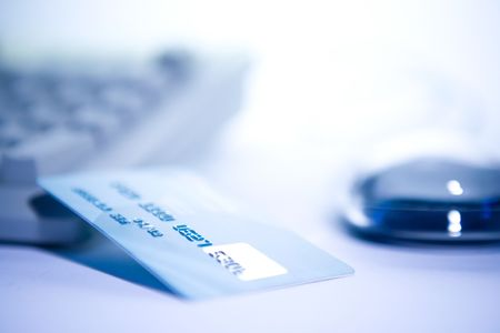 Credit card and computer. Online shopping. photo
