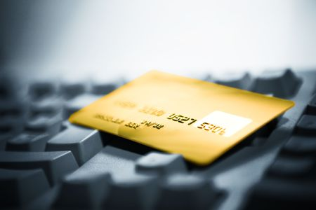 Credit card and computer keyboard. Online shopping. Stock Photo