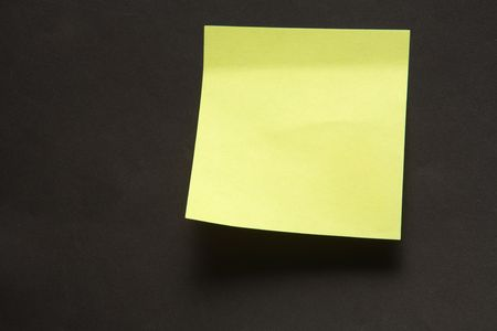 posting: Sticky note attached on a black background