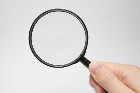 closer: Magnifying glass in hand over white background