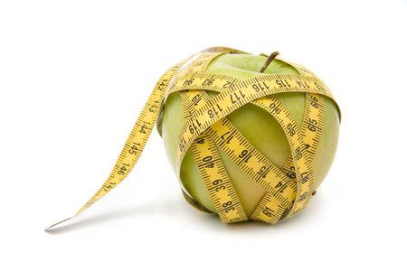imprisoned: Apple imprisoned by a measuring tape.