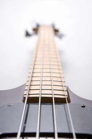 and worn out: Electric bass guitar with four strings