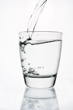 Pouring water to a clear glass