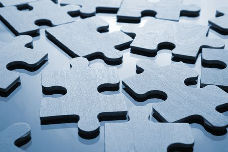 Assembling the puzzle piece by piece Stock Photo - 1296863