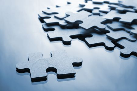 Assembling the puzzle piece by piece Stock Photo - 1296864