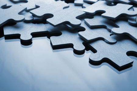 Assembling the puzzle piece by piece Stock Photo - 1296865