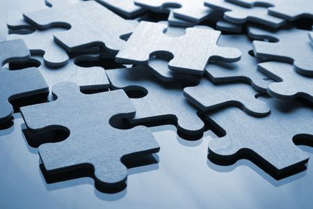 Assembling the puzzle piece by piece Stock Photo - 1296866