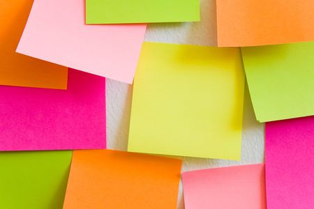Blank sticky notes attached to a white wall. photo