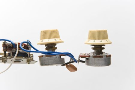 strat: Electronic parts from vintage electric guitar Stock Photo