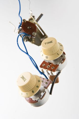 Electronic parts from vintage electric guitar photo