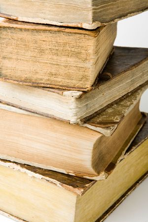 yellowish: Pile of old books on white background