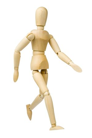 Wooden model dummy in walking posture. Isolated on a white background. Stock Photo