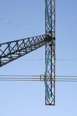 hight tech: High voltage electricity pylon structures against blue sky