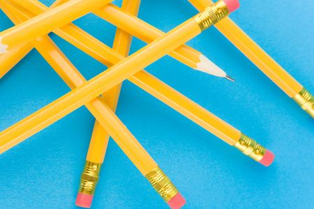 writing utensil: Yellow pencils on blue background