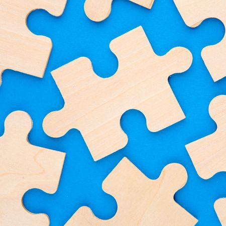 Wooden puzzle pieces on blue background Stock Photo - 2517730