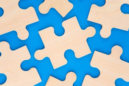 Wooden puzzle pieces on blue background Stock Photo - 2517762
