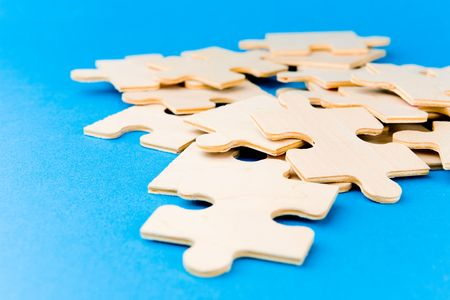 Puzzle pieces on blue background Stock Photo - 2517738