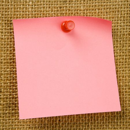 attached: Sticky note attached to bulletinboard Stock Photo