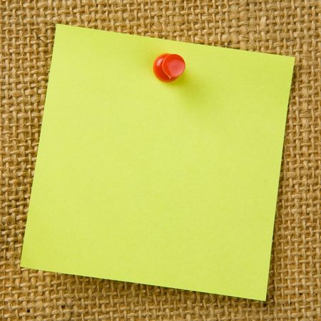 bulletinboard: Sticky note attached to bulletinboard Stock Photo