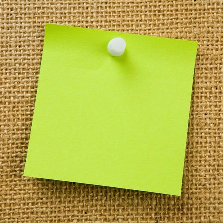 Sticky note attached to bulletinboard Stock Photo