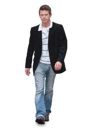 personas caminando: Hombre caminando en jeans aisladas en blanco  Foto de archivo