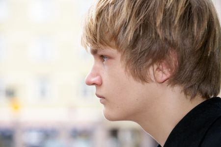 Teenage boy side profile, close-up headshot Stock Photo - 3448086