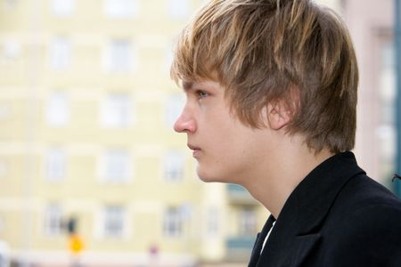 Teenage boy side profile, building in background Stock Photo - 3448069