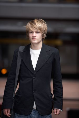 only one teenage boy: Portrait of teenage boy standing in street Stock Photo