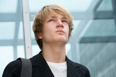 Teenage boy contemplating in urban environment, looking up Stock Photo - 3465992