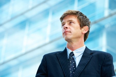 Man outside office building Stock Photo