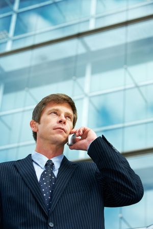 Man outside office building, using cell phone Stock Photo - 3473015