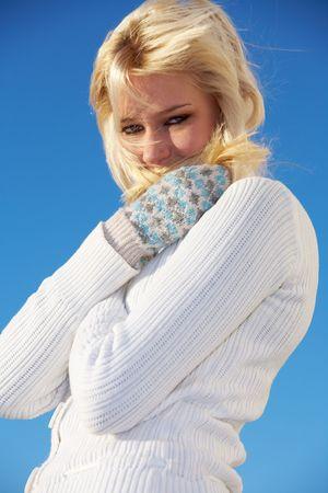 teenaged: Teenage girl trying to keep herself warm, looking at camera Stock Photo