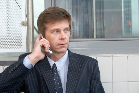 businessman waiting call: Portrait of man using cell phone