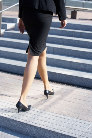 Businesswoman walking up stairs on stairway, low section Stock Photo - 3489425