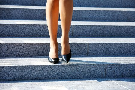 Woman stepping down on stairway in city Stock Photo - 3489447