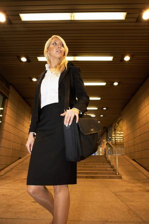 woman s bag: Young businesswoman carrying laptop, low angle view Stock Photo