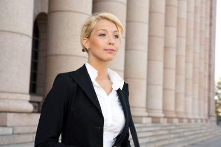 Portrait of young businesswoman outside building