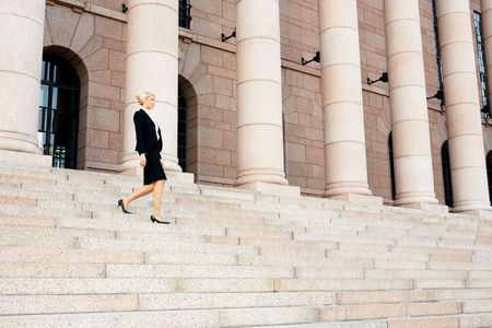 Businesswoman walking down the stairs of building
