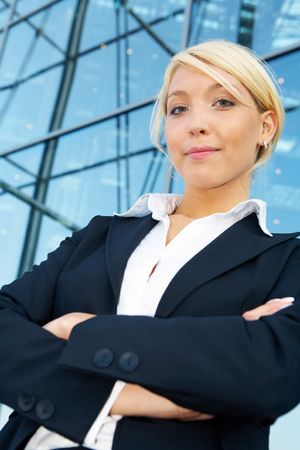 Young businesswoman arms crossed, looking at camera Stock Photo - 3505221
